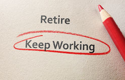 Retire or keep working. Keep Working circled in red below Retire text Royalty Free Stock Photos