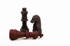 Retire the King. Chess King layin down beside a king and a rook Stock Image