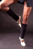 Retire position legs ballerina. Legs of a ballerina performing the retire position Stock Photography