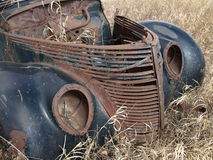 Retired automobile. This car has been permanently retired you might say it has been put out to pasture Stock Image