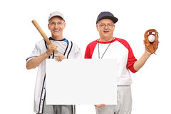 Retired baseball players holding a sign Stock Photo
