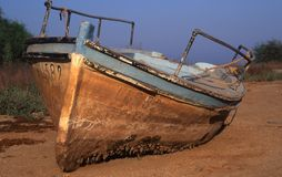 Retired boat. A retired boat outside in a coast Stock Image