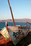 Retired boat on the shore. An old rusty retired boat on the shore royalty free stock photos