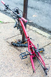Retired city veteran - bicycle chained to a pole incapacitated. Stock Photography