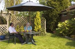 Retired couple. Relaxing in the garden Stock Image