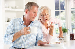 Retired couple arguing at breakfast Stock Photography
