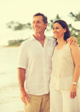 Retired Couple on the Beach. Romantic Retired Couple Relaxing on Vacation Stock Photo