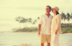 Retired Couple on the Beach. Romantic Retired Couple Relaxing on Vacation Stock Photography