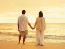 Retired Couple on the Beach. Romantic Retired Couple Relaxing on Beach Vacation at Sunset Stock Photography