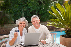 Retired couple buying something on internet Stock Images