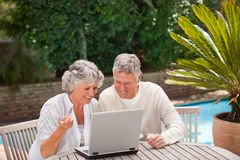 Retired couple buying something on internet Royalty Free Stock Photography