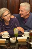 Retired couple in cafe Royalty Free Stock Images