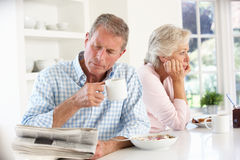 Retired couple eating breakfast Royalty Free Stock Image