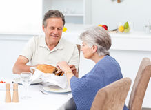 Retired couple eating  in the kitchen. At home Royalty Free Stock Image