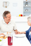 Retired couple eating  in the kitchen Royalty Free Stock Images