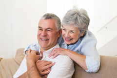 Retired couple embracing Royalty Free Stock Image