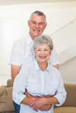 Retired couple embracing and smiling at camera Royalty Free Stock Images