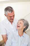 Retired couple embracing and smiling at each other Stock Photography