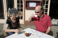 Retired couple enjoying coffee Stock Photo