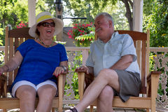 Retired Couple Having Fun Conversations Royalty Free Stock Photos