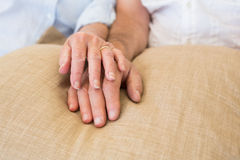 Retired couple holding hands Royalty Free Stock Photo