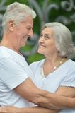 Retired couple hugging Royalty Free Stock Image