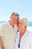 Retired couple listening to their shell Royalty Free Stock Photos