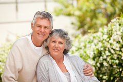 Retired couple looking at the camera Royalty Free Stock Image