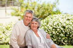 Retired couple looking at the camera Royalty Free Stock Photos