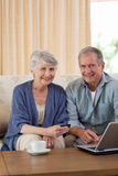 Retired couple looking at their laptop Stock Photo