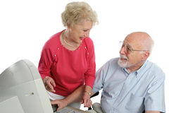 Retired Couple Online. An attractive retired couple surfing the net together. Isolated Royalty Free Stock Image