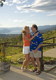 Retired couple outdoors. Tourist couple at scenic viewpoint Stock Photography