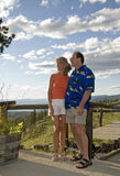 Retired couple outdoors. Tourist couple at scenic viewpoint Stock Images