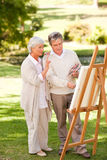 Retired couple painting. In the park Royalty Free Stock Photo