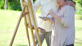 Retired couple painting together Royalty Free Stock Photo