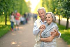 Retired couple in park stock images