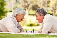 Retired couple playing chess Stock Photography