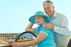 Retired couple ride in boat on sea Royalty Free Stock Photos