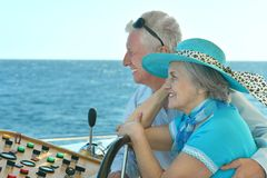 Retired couple ride in boat on sea Royalty Free Stock Images