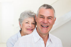 Retired couple smiling at camera Stock Images