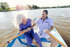 Retired couple spending time on a boat. Together. Active seniors. Fun vacations Stock Image