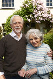 Retired Couple Standing Outside Pretty Home Royalty Free Stock Image
