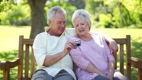 Retired couple taking a picture together Royalty Free Stock Photo