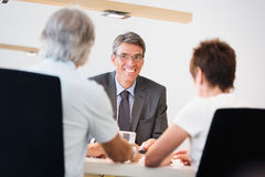Retired Couple Talking To Their Financial Advisor Stock Images