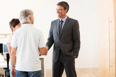 Retired Couple Talking To Their Financial Advisor royalty free stock photography