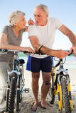 Retired couple with their bikes on the beach. Active retired couple with their bikes on the beach Royalty Free Stock Photography