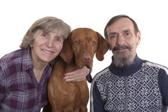 Retired couple with their dog. Retired happy couple with their dog Royalty Free Stock Images