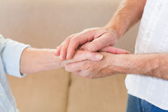 Retired couple touching hands Royalty Free Stock Image