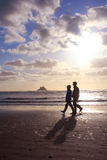 Retired Couple Walking on the Beach Royalty Free Stock Photo
