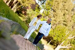 Retired couple walking outdoors Royalty Free Stock Images